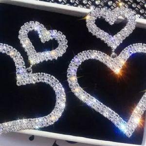 Sterling silver plated crystal drop heart earings
